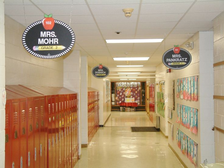Welcoming School Hallway Signs: These are double-sided and magnetic so they are easy to update with magnetic lettering.  This is alot easier to see than the traditional name plate above the teacher's doorway. #school hallway signs #teacher signs #school signs