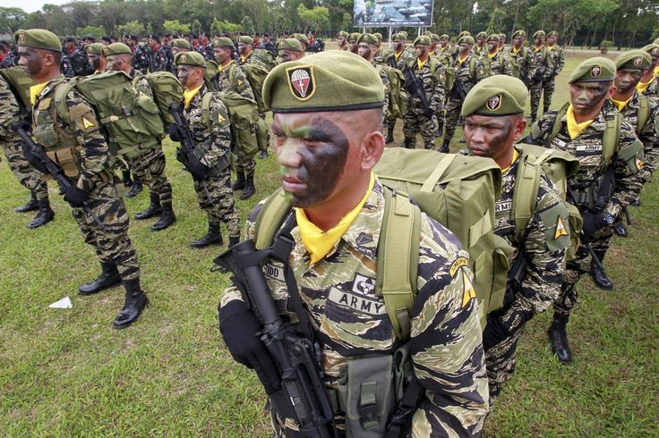 Troops stand at attention during the celebration of the 118th Founding Anniversary of the Philippine Army at the military headquarters in Fort Bonifacio,