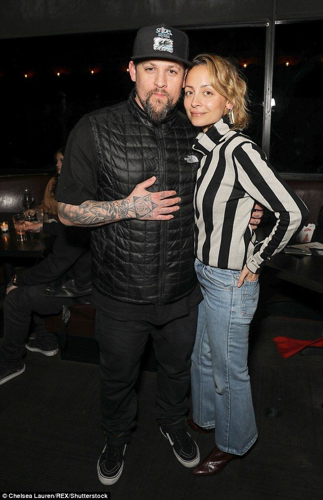 Stylish couple: Nicole Richie, 35, donned a Beetlejuice inspired top and flared jeans as she cosied up to her husband at the MDDN presents Chase Atlantic event in LA on Thursday