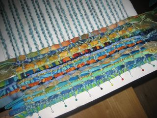 Weaving with fabric strips intrigues me.