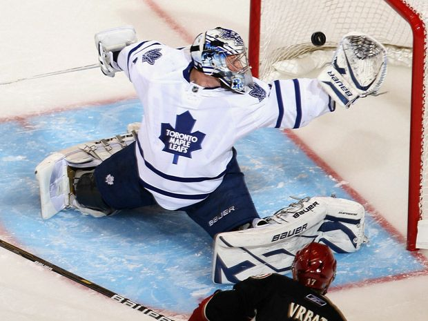 Toronto Maple Leafs - James Reimer - Glove save.