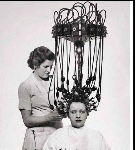Electric curlers !!! Commonly used in hair salons in the 1920's and 30's.  My Mother use to have her hair done like this. She said it would be so hot that it would burn your scalp.