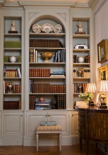 "While not quite a ""library"", shelves make wonderful places to store books and other pretty things. I especially like the arched center focus and the doored cabinets underneath are always important for extra storage. -B33Happy Honey - Room by Leta Austin Foster."