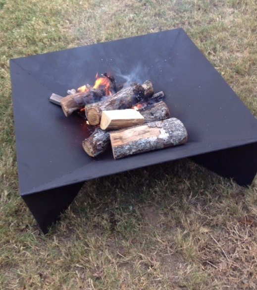 Don't go for an everyday fire pit. Find something that is artistic. Contemporary Fire Pit. $500.00, via Etsy.