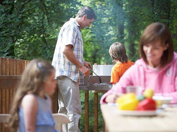 A family BBQ on the cabin decking.