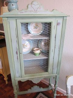 Antique China Cabinet painted in Miss Mustard Seed's Luckett's Green with chicken wire in door, so cute! By Bliss and Blossom Designs