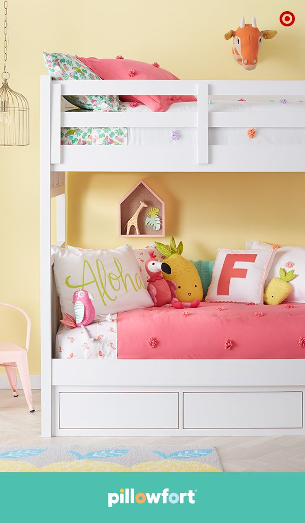 """Here comes the sun—to your kid's bedroom. Pillowfort's Tropical Treehouse collection brings a tropical vibe with fun details like fun flamingos, pineapple pillows, a cute giraffe wall mount and a an Aloha pillow. The colorful mix-and-match bedding lets little ones pick their favorite patterns, and adds extra personality to bunk beds (like when siblings share rooms or for BFF sleepovers). How amazing is that?"""