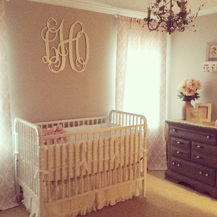 """Lundy's blush pink, ivory, gray and white shabby chic nursery! 26-inch painted wood monogram letters by """"A Charmed Nest"""" on Etsy. Crib is Jenny Lind in antique distressed white/gray. Bedding is white ruffle bedding by Pottery Barn Kids. Chandelier by Ballard Designs. Curtains are """"silver french damask"""" pattern by Carousel Designs. Ruffle pillow from TJ Maxx."""