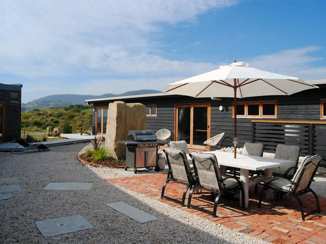 Enjoy the privacy of the sunny courtyard   Malibu on the Beach - oceanfront retreat in Four Mile Creek, Tasmania