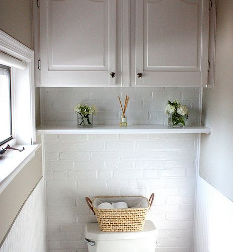 shelf and cabinet over toilet - I need something like this in our master bathroom.  Adding storage makes me happy.  :)