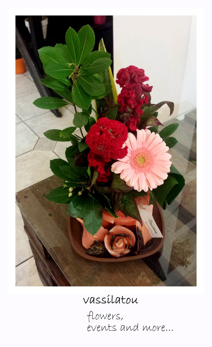 red flower arrangement in candle pot www.vassilatou.gr flowers, events and more...