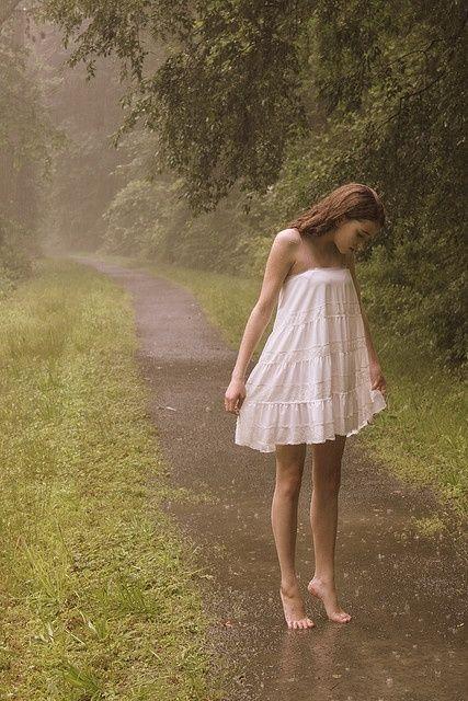 Tiptoe in the rain rain storm girl outdoors trees wet