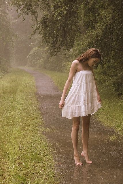 Tiptoe in the rain rain storm girl outdoors trees wet