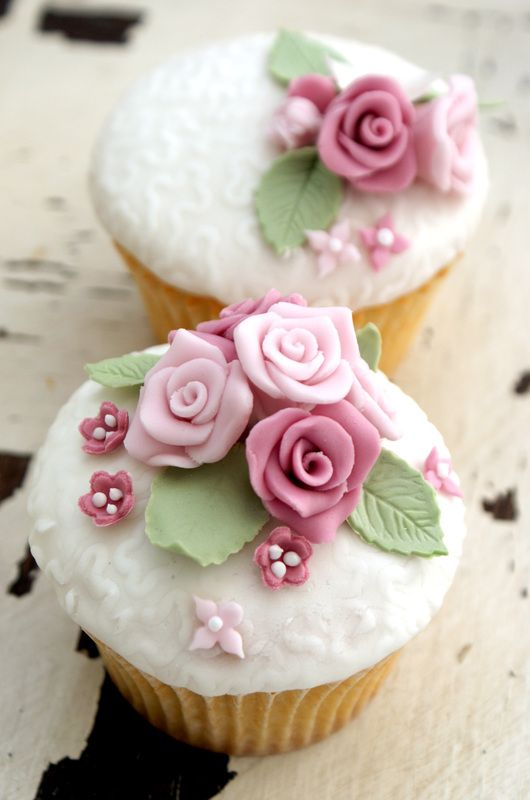 Pink, rose and ivory embossed fondant cupcakes with roses, little flowers, pearls and leaves.