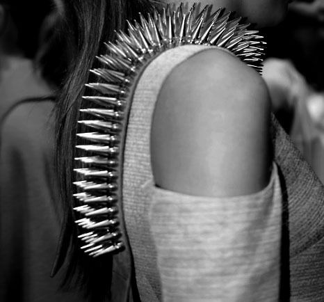 Spiked shoulder-strap to the extreme.