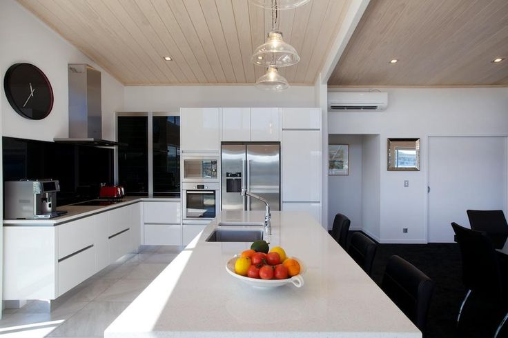 Modern white kitchen which shows off the homes gib wall features