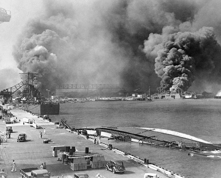 . In this image provided by the U.S. Navy, a pall of smoke filled the sky over Pearl Harbor, Hawaii on Dec. 7, 1941, after the Japanese attacked. In the foreground is the capsized minelayer, the USS Oglala, and to the left appears the moored USS Helena, 10,000-ton cruiser, struck by a bomb. Beyond the superstructure of the USS Pennsylvania, and at the right is the USS Maryland, burning. At right center the destroyer Shaw is ablaze in drydock. (AP Photo/U.S. Navy)