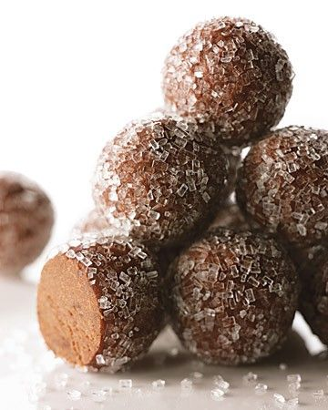 To make these rum balls, begin by baking a batch of rich, fudgy brownies. The cooled brownies are crumbled, mixed with dark rum, formed into balls, and rolled in coarse sanding sugar for sparkle and crunch.