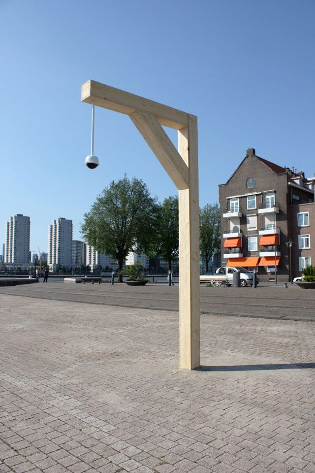 Sil Krol - Deterrent, public intervention, wood, CCTV dome camera. Noordereiland Rotterdam, 2012.  #public #intervention, #contemporary #art #gallows #CCTV #security #camera