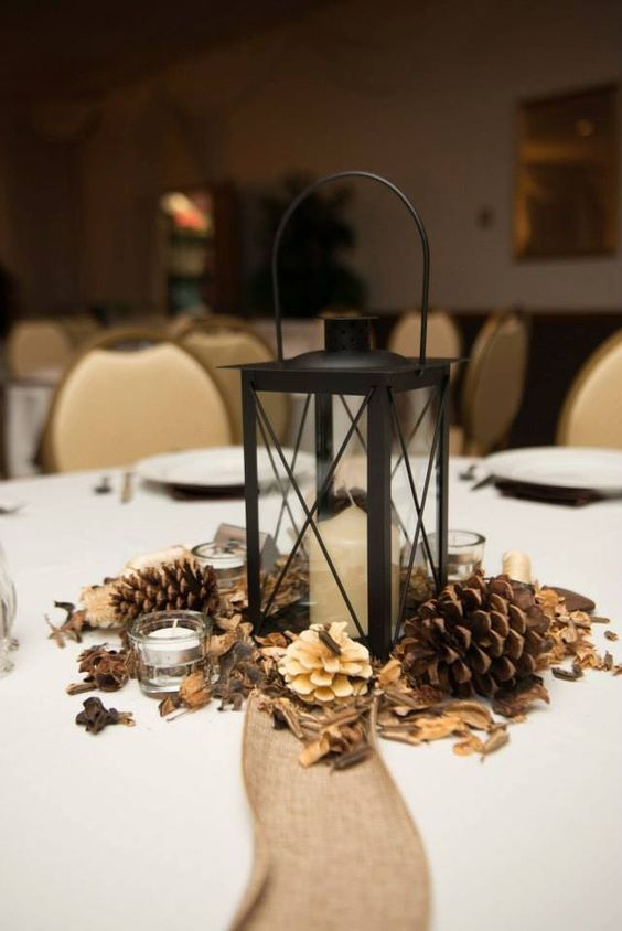 lantern pinecone winter wedding centerpieces / http://www.deerpearlflowers.com/rustic-winter-pinecone-wedding-ideas/