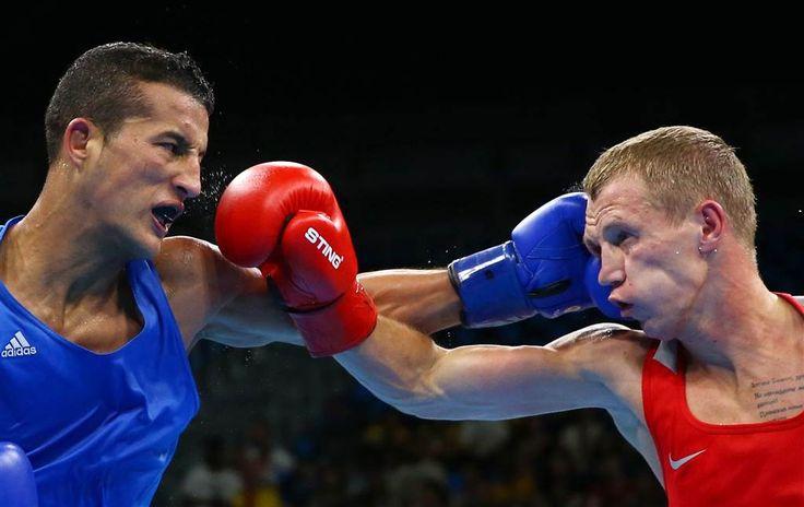 Olympic Moments: Boxers Exchange Blows, Handballers Take Aim - NBC News