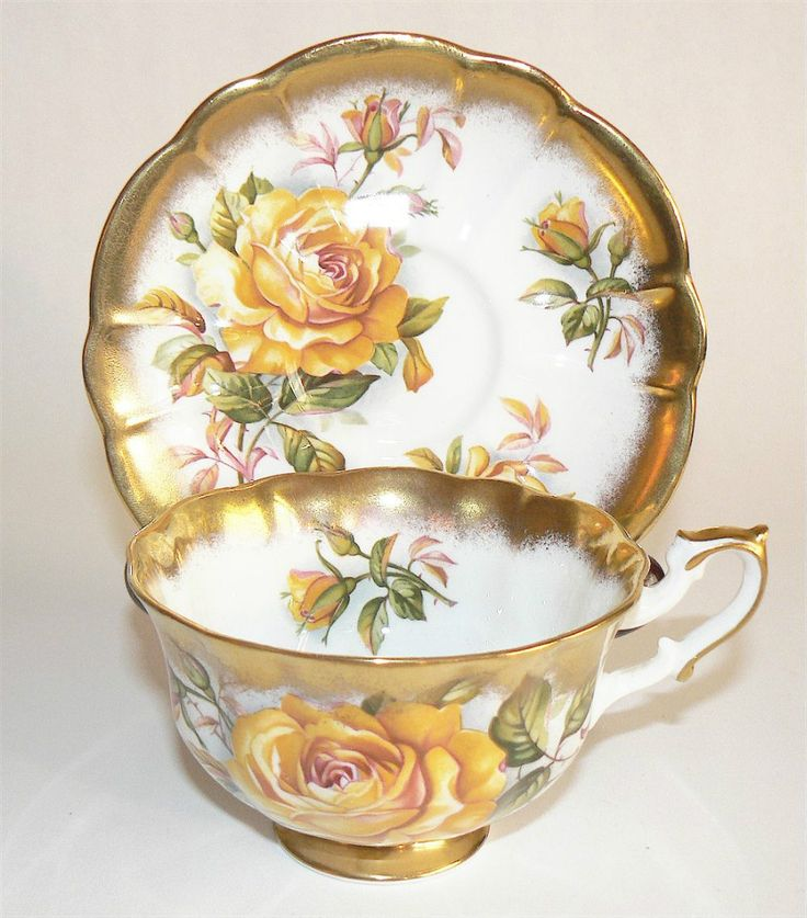Lovely vintage tea cup and saucer with golden yellow Roses and scalloped edges trimmed in gold!