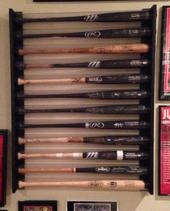 12 Baseball Bat Display Holder Rack – Wall Mount – Holds 12 Baseball Bats - MLB by 2Markers on Etsy https://www.etsy.com/listing/261433769/12-baseball-bat-display-holder-rack-wall