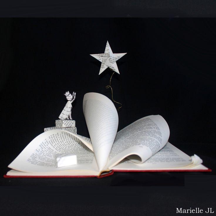 LIvre-sculpture représentant la poésie, le monde imaginaire que peut contenir un livre... Une oeuvre toute en douceur, refétant ces : Sculptures, gravures, statues par mariellejl