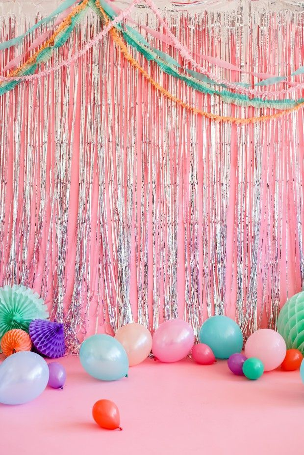 metallic fringe, colorful garlands and balloons for a fun kid's party.