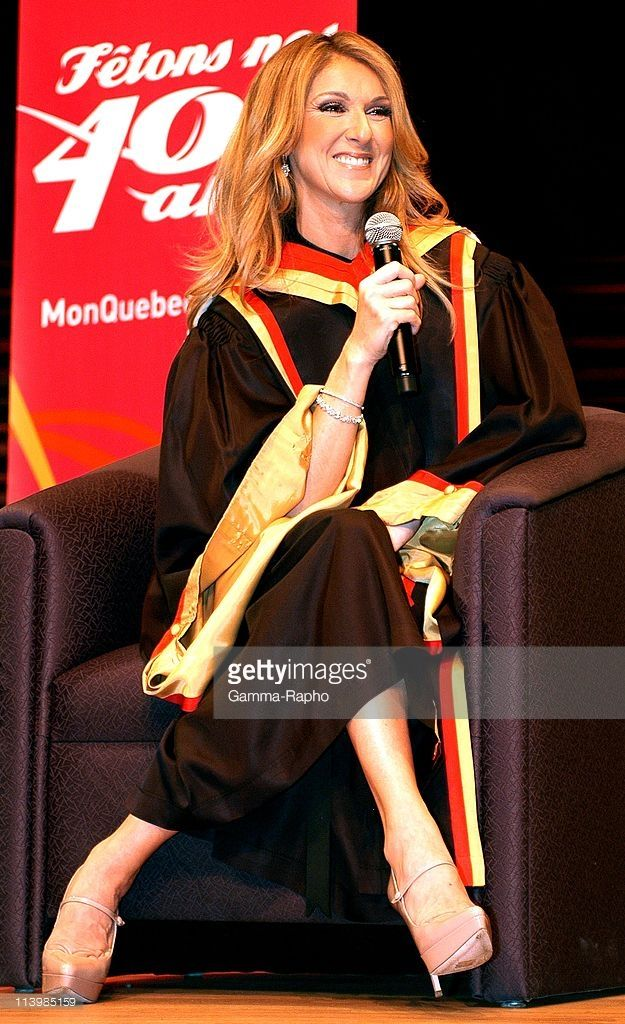Celine Dion gets honourary doctorate in Quebec, Canada on August 21, 2008-Canadian singer Celine Dion smiles as she receives an honorary doctorate in music from Laval University superintendent Denis Briere during a ceremony at the Palais Montcalm in Quebec City.