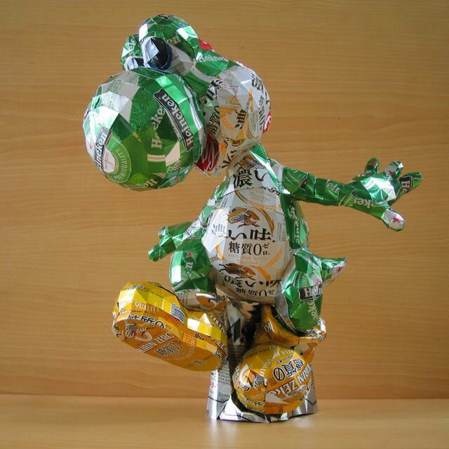 Yoshi sculpture made out of recycled materials for Things to make out of recycled stuff