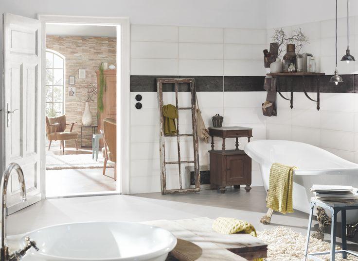 Miroir esprit tulipe, robinetterie teintée, receveur empreint de soleil, carrelage interprétation carreau ciment… l'esprit bohème dans sa salle de bain.