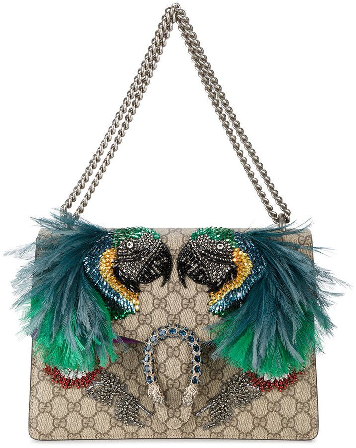 Gucci parrot purse- feather embellished shoulder bag. This parrot motif Dionysus shoulder bag will make your heart soar with its tropical vibes. Multicoloured leather Dionysus feather embellished shoulder bag from Gucci featuring a foldover top with magnetic closure, Gucci Supreme logo pattern, a signature Dionysus tiger plaque, an accordion pleat design, crystal accents, beaded embroidery and feather applique detailing.