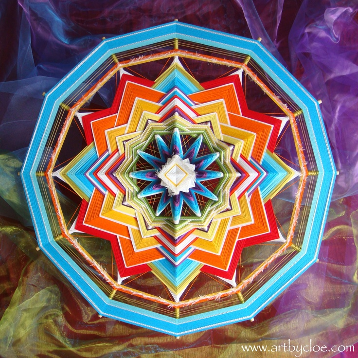 this is a 90 cm mandala woven from cotton yarn and wooden sticks.  start from the centre and go round round round.....! also called ojo de dios, eye of god....