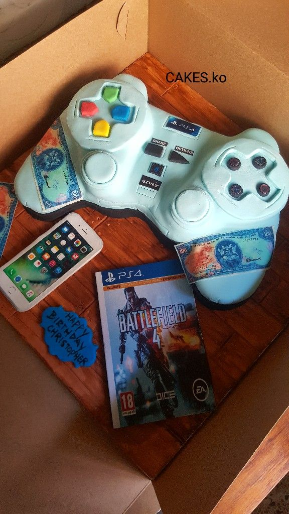 Did this ps4 cake for a birthday guy. Everything is edible.Click link to my business page for more of my work.