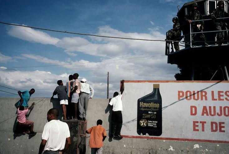 Alex Webb HAITI. Port-au-Prince. 1994. Haitians with the U.S. military.