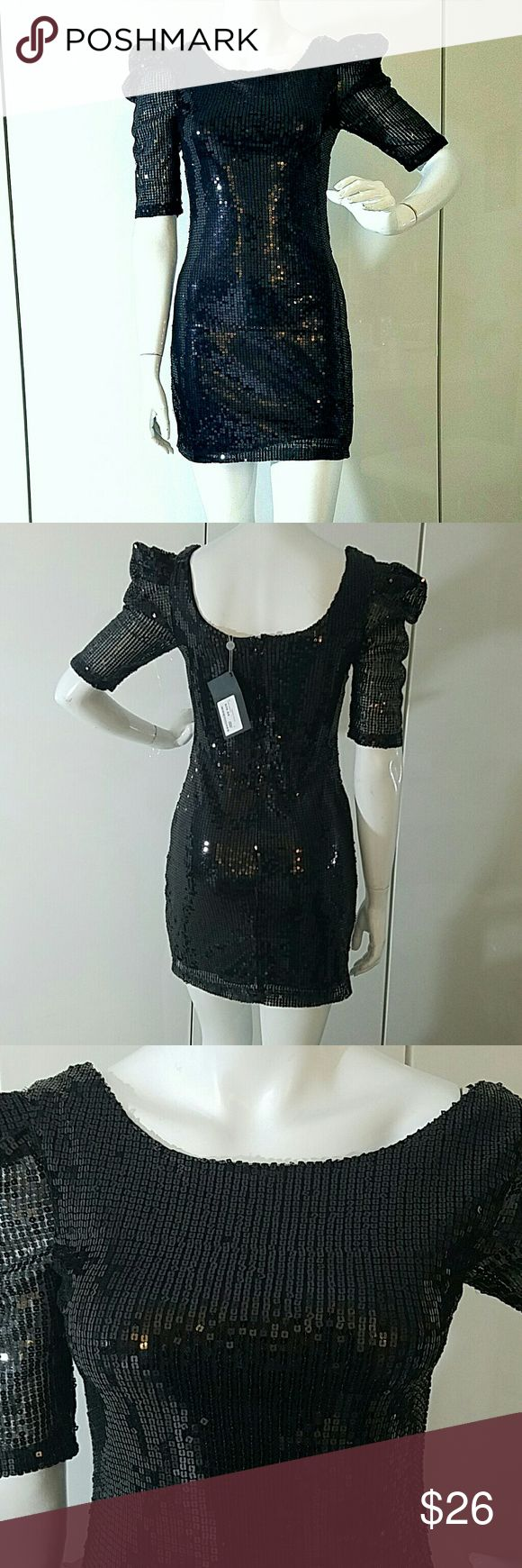 NWT Urban behavior black sequin puff sleeve dress NWT Urban Behavior sequin puff sleeve dress Size small Beautiful all over square sequins Absolutely stunning Zip back  Elbow length sleeve  Lined bodice urban behavior  Dresses Mini