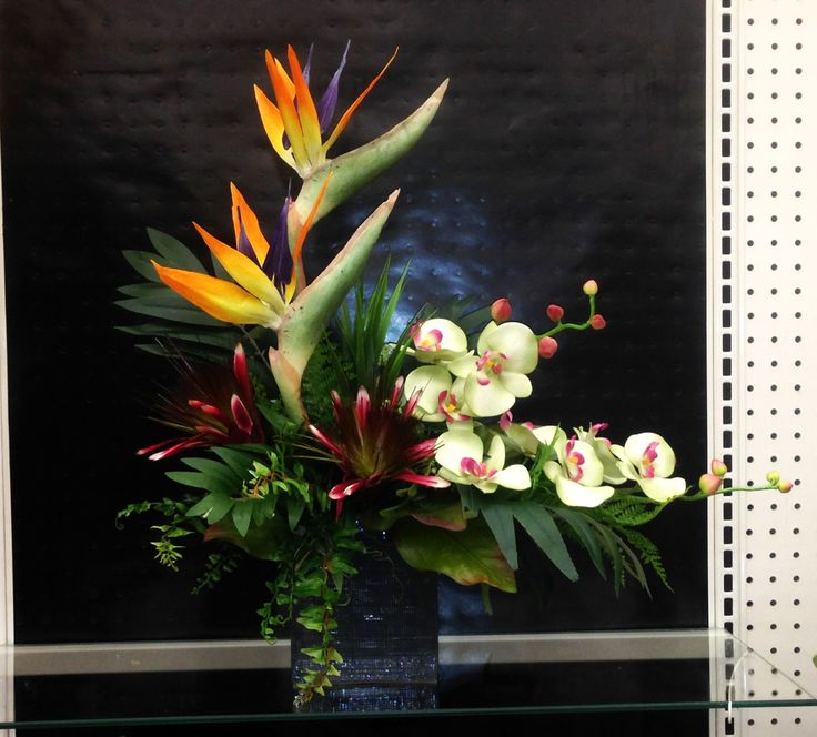 tropical birds and orchids arrangement