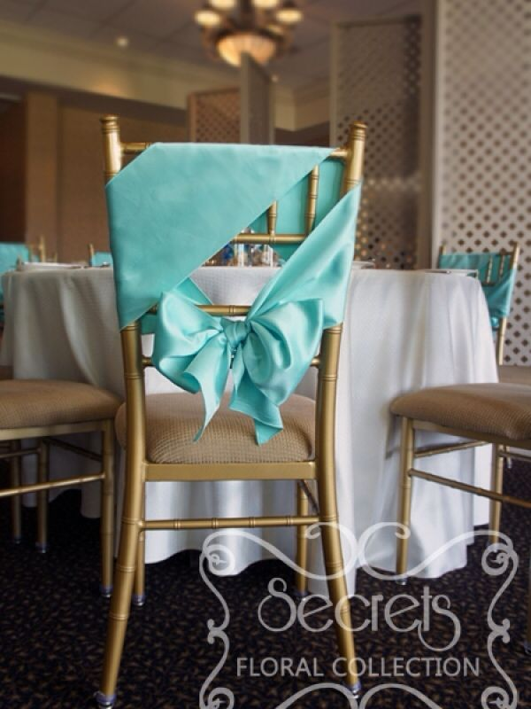 Uniquely tied chair sashes without the chair cover. Aqua blue.