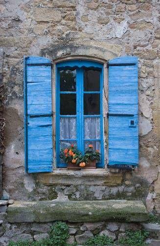Blue window shutters in Provence