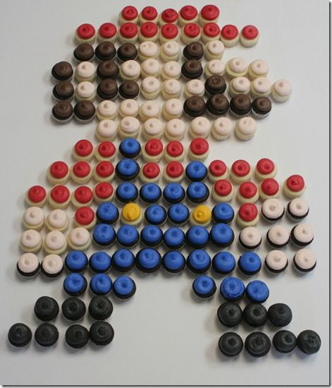 """assorted colored mini cupcakes lined up to make """"Mario"""".  Cool!"""