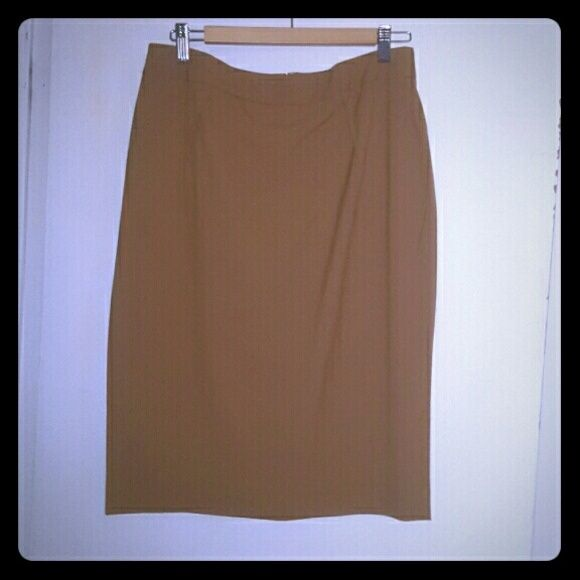 Body by Victoria pencil skirt Excellent condition. A darker tan color. Zipper in back. One slit up back. Skirt reaches passed my knees. It measures approx 24 inches long.  OFFERS WELCOMED! Victoria's Secret Skirts Pencil