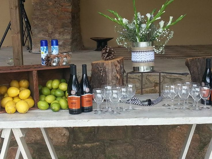Rustic drinks table - check out the mosquito spray!!