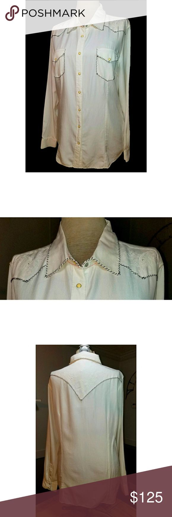 """Ryan Michael Embroidered White Dressy Blouse NWT Western Shirt Pearl Snap Frontandcuffs Darts at the bust Fitted seams down the front and back Long sleeve Silk & Cotton XL NWT  Beautiful white on white embroidery on shoulders and top of back! Retail: $162.00 Measurements: Shoulders: 18"""" Underarm to underarm:24"""" Waist (at narrowest point): 22"""" Length:29"""", about 1"""" longer in the back 53%Silk,47%Cotton Machine wash cold/tumble dry low Ryan Michael Tops Blouses"""