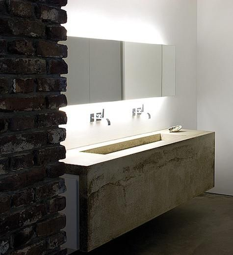 :: BATHROOMS :: Photo Credit: Belgian architect Bruno Erpicum (see Architect Visit: Bruno Erpicum & Partners); we also like this warehouse conversion in Dusseldorf that Erpicum designed for an art-collecting couple. - simple wall hung bathroom vanity in stone with back lit floating mirror #bathrooms