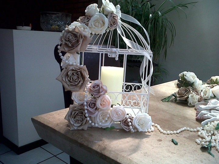 birdcage with flowers and pearls
