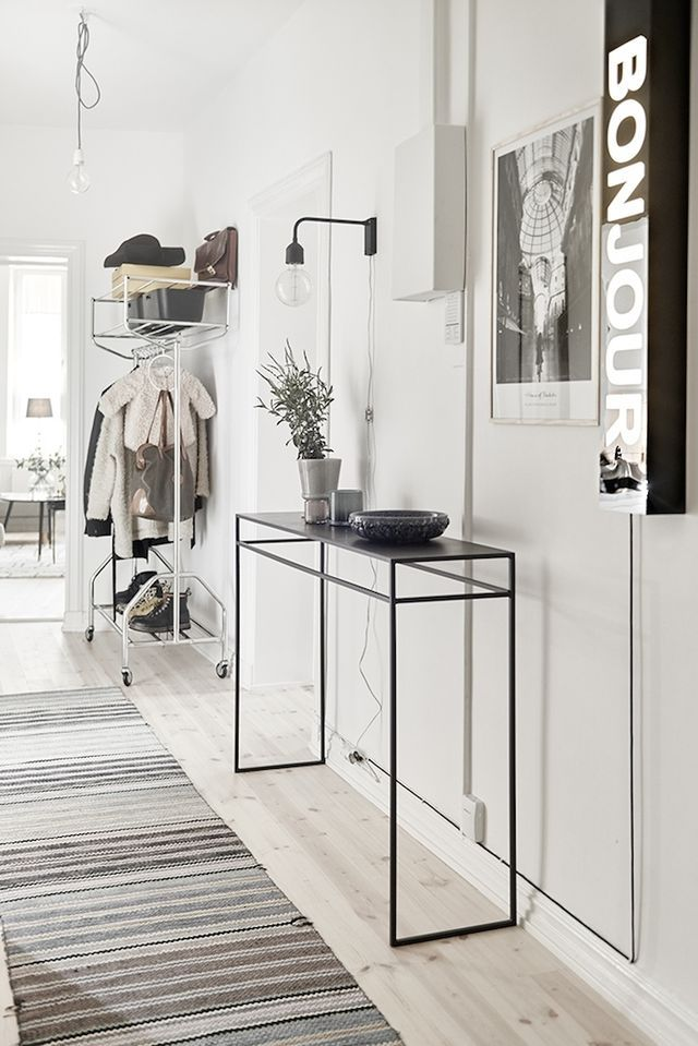 Beautifully styled apartment in Gothenburg, Sweden. With the typical wood floors, double doors, white interiors and eclectic styling … love the tiles in the bathroom/laundry, the gallery wall in the l