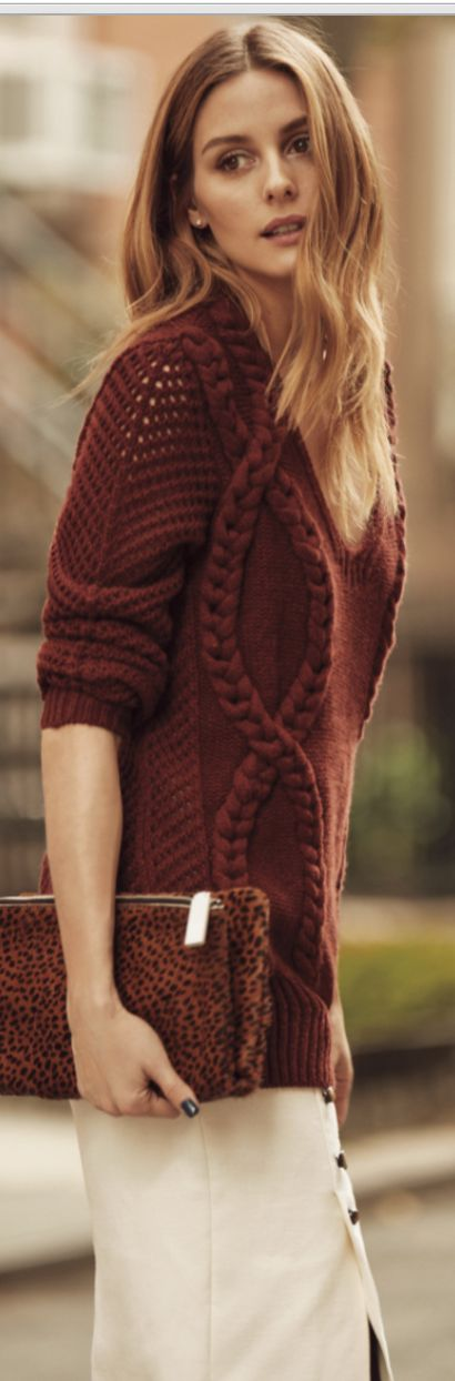 Who made  Olivia Palermo's red braided sweater and leopard clutch handbag? Sweater, purse, and skirt – Banana Republic