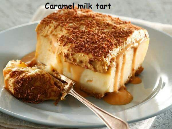 Caramel milk tart 250 g Tennis biscuits, finely crushed 200 g butter, melted 1,5 litres milk 200 g sugar 3 eggs 100 g flour 100 g cornflour 10 ml (2 t) vanilla essence 50 g butter extra 250 ml (1 c) milk 1 box (90 g) caramel instant pudding 250 ml (1 c) cream 1 can (360 g) caramel condensed milk 1 slab (90 g) milk chocolate 1 Mix the biscuits with the melted butter and press onto the bottom of a deep 30 cm square dish. Chill until needed. 2 In a large microwave-proof bowl heat 1 litre (4 c)…
