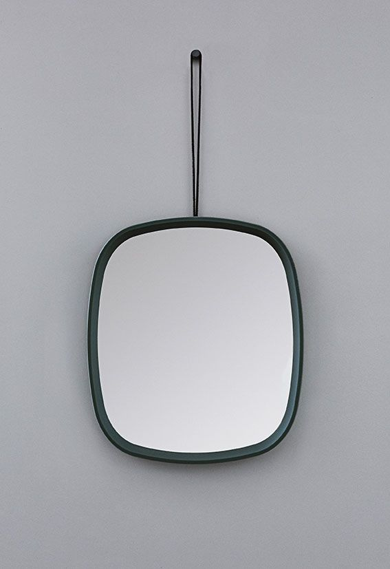 Television mirror! Comes in grey or turquoise with a leather strap for hanging. Hang it vertically or horizontally. For the bathroom, entrance or kids room.